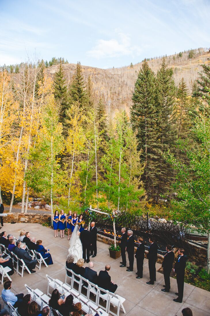 """""""I've always wanted an outdoor wedding in the fall (my favorite season!),"""" Kimberly says. """"The outdoor backdrop of the Cascade deck was absolutely breathtaking—especially in October with the golden Aspen leaves fluttering and falling all around us as the mountain creek rushed by ahead of us. God couldn't have painted a more colorful, amazing outdoor portrait for us!"""""""