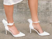 White pumps with pointed toe and bow on ankle strap