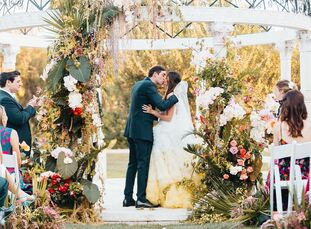 """Perry Silverman and Adam Rosen based their wedding on """"La Vie en Rose"""" as a nod to Perry's love of flower arranging and their hashtag, #chosenrosen. T"""