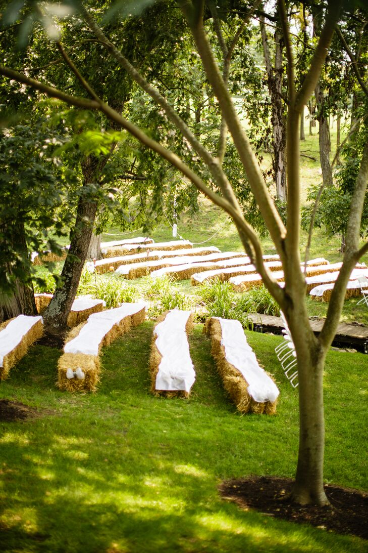 Kristie and Ryan had vintage and rustic decor, and each accent at the ceremony reflected their tastes.  All 150 of their guests sat in rows of white fabric-covered hay bales or a few white folding chairs for the outdoor wedding at Highland Vue Farms in Newville, Pennsylvania.