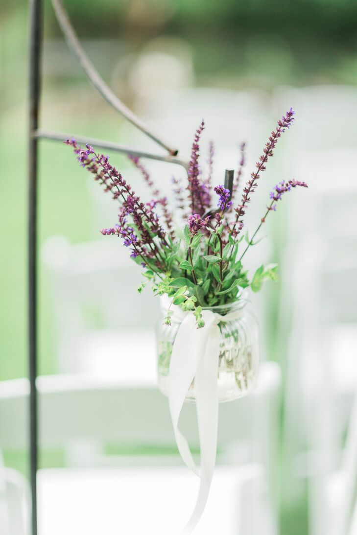 The ceremony aisle was lined with hanging mason jars wrapped in ivory ribbon and filled with lavender.
