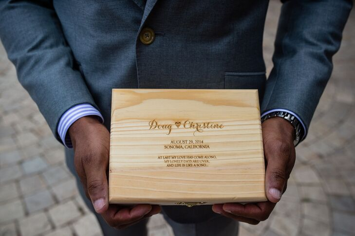 During the ceremony, the two ring bearers carried a wooden box down the aisle, carved with Christine's and Doug's first names, their wedding date and lyrics from the song that they shared their first dance to.