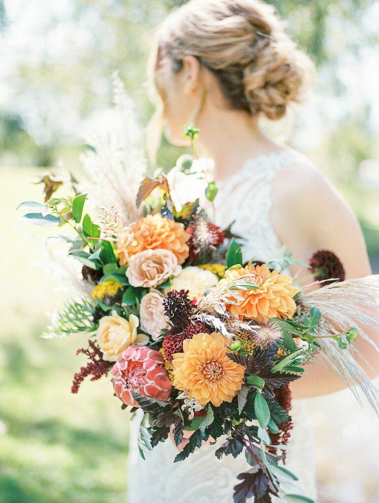 Bride holding dahlia bouquet