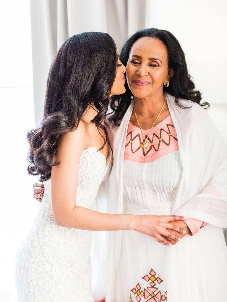 bride kissing mother