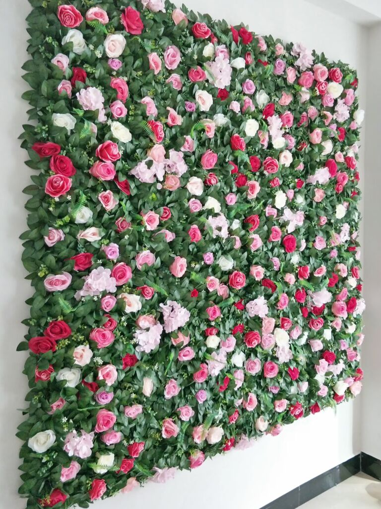 Pink, red and white roses and greenery wall panel backdrop