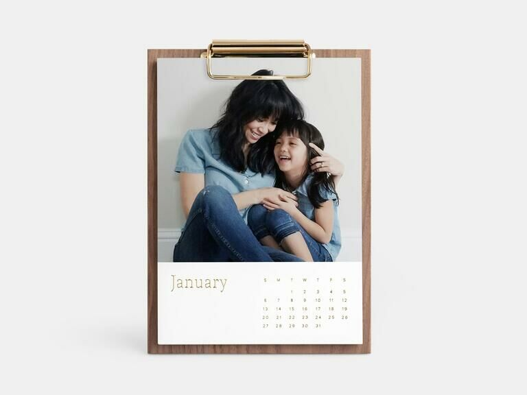 Personalized photo calendar on walnut clipboard with photo of mom and daughter