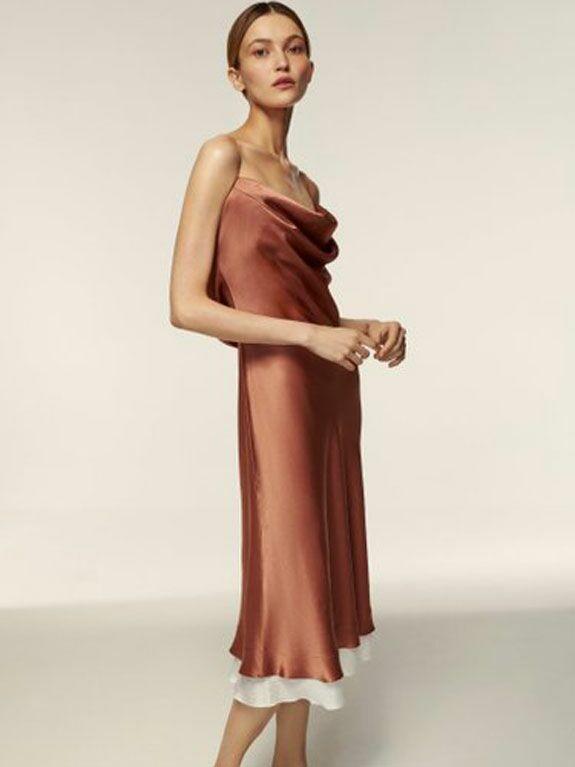 Copper satin cowl neck slip wedding guest dress for fall with white hemline