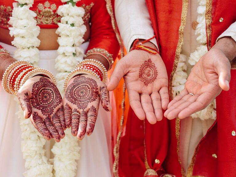 Bride and groom matching henna tattoos