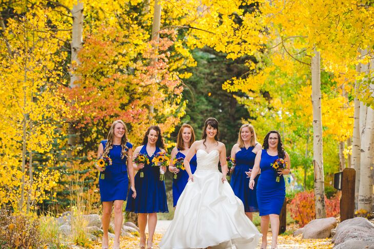 The bridesmaids wore knee-length royal blue dress in the style of their choice. They completed their look with their own nude heels.