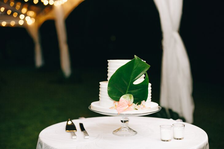 The couple's simple two-tiered cake was decorated with a single tropical green leaf.