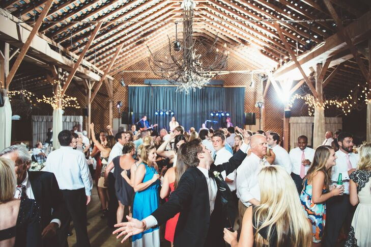"""""""Our band, The Dickens, was amazing and got the party rocking immediately following the dinner,"""" says Casey. """"Everyone worked up quite a sweat on the dance floor, so we served late night food—French fries and ice cream sandwiches— later into the night."""""""