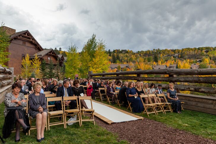 Emily and Chris enhanced the existing beauty of Skier Bridge with lush garden roses and a wooden walkway as an aisle runner.