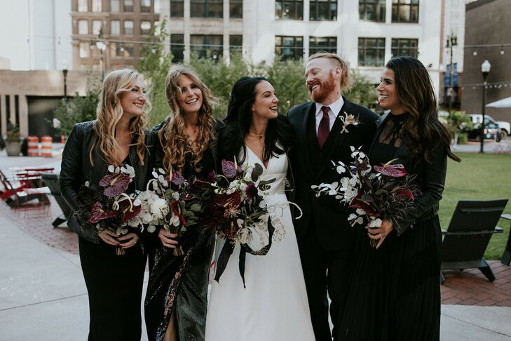Alternative Wedding Party with Black Dresses and Moody Bouquets