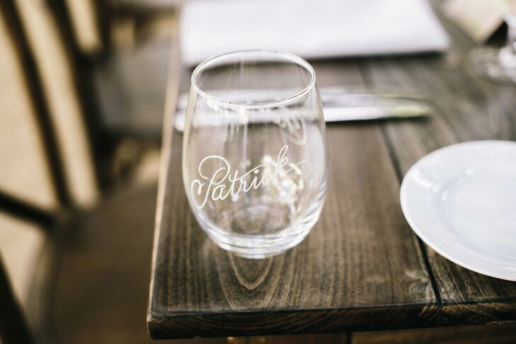 Etched wineglasses added a personalized touch to each ethereal place setting.