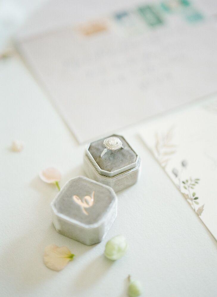 Elegant White Gold Halo Engagement Ring in Gray Ring Box