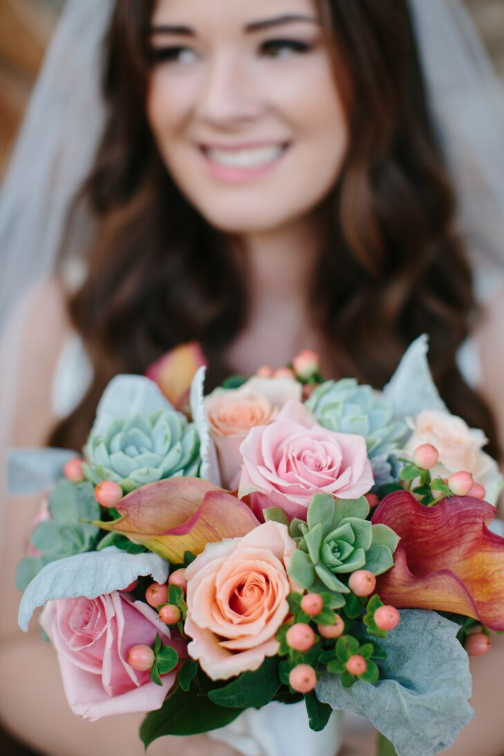 """Based on what Katie told the Garden District, the florist created a beautiful pink and orange bouquet filled with roses and succulents, not to mention a red calla lily or two added into the mix. """"My grandmother unexpectedly passed away seven months before the wedding,"""" Katie says. """"I wrapped a gold coin necklace of hers around the base of the bouquet for a little sentimental value of having her with me."""""""