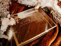 Glass shadowbox with couple's names and wedding date in minimalist white type