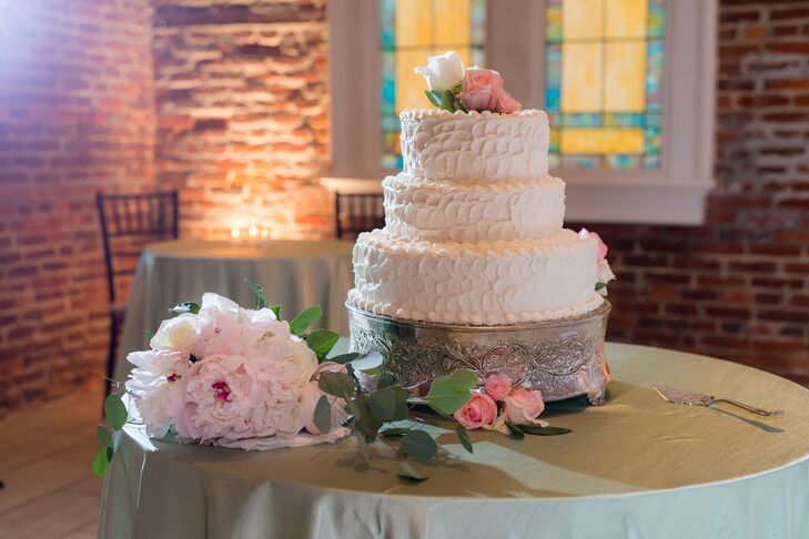 At the end of the night, Elizabeth and Tim enjoyed a three-tiered almond cake filled with chocolate ganache, fresh strawberries and buttercream. The outside was decorated with textured buttercream to match the rustic, industrial feel of the venue.