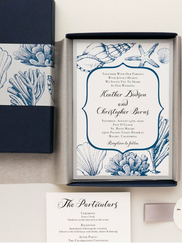 Seashell designs in blue with elegant border around event details in black calligraphy in taupe box