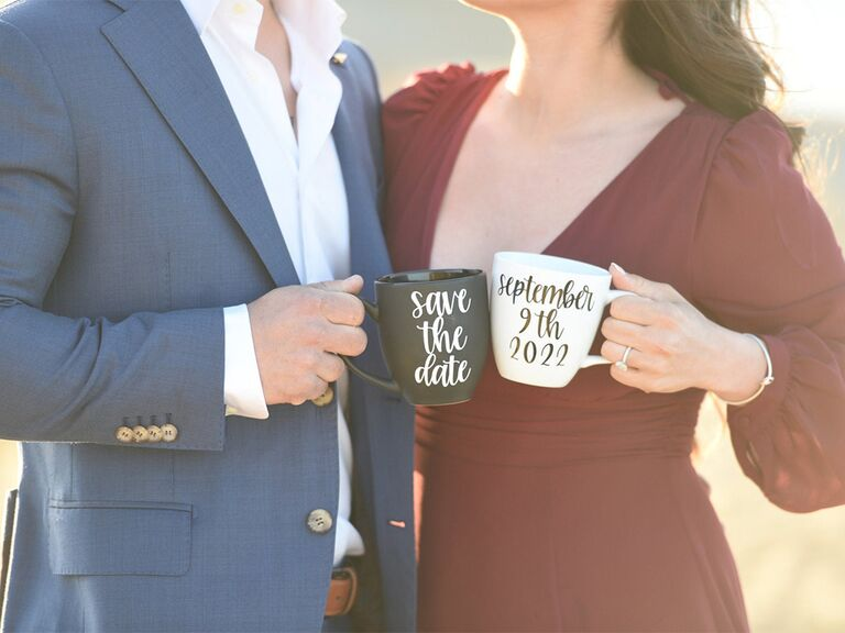 Black and white coffee mugs with 'save the date' and date in black or white script