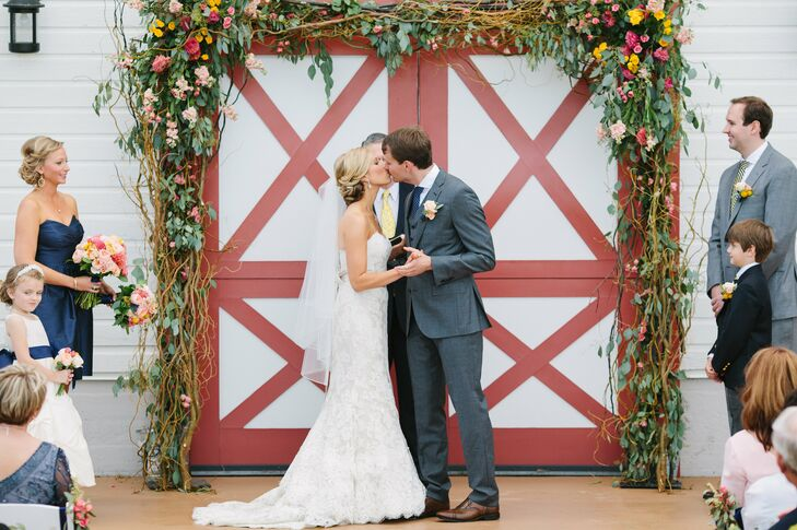 Working with a color palette of midnight blue, golden yellow and pops of pink in a barn-meets-loft venue, Ryan and Matthew had a country-prep wedding