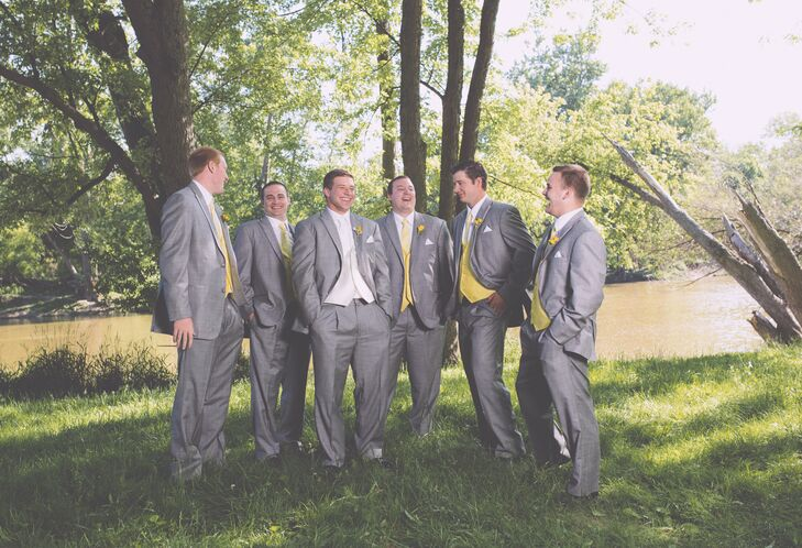 The groomsmen's suits fit the theme of bright simplicity. Their light gray suits were a casual fit on top of bright yellow vests and white boutonnieres. To stand out against the groomsmen, the groom wore a white vest and matching tie.