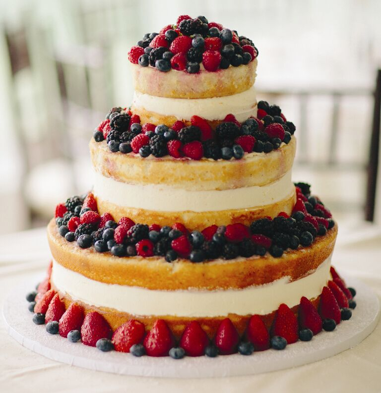 Three-tier naked bridal shower cake with fresh berries