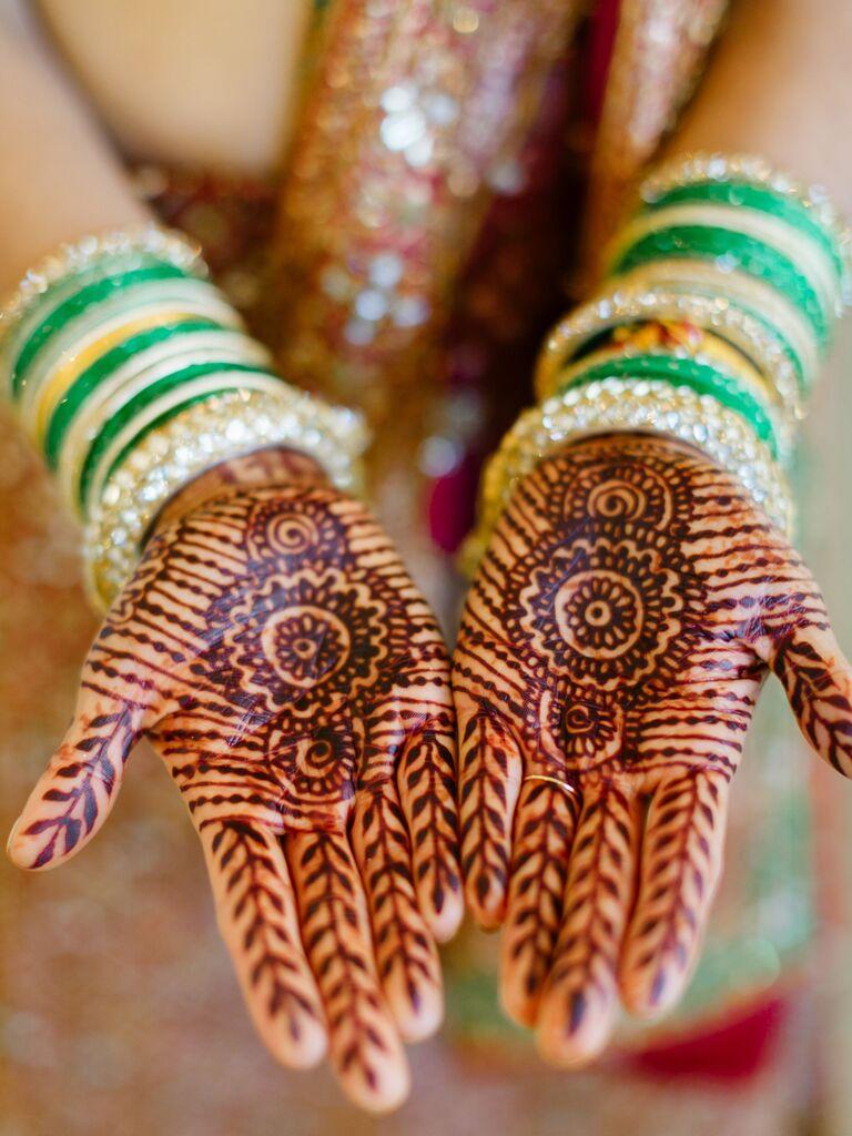 Intricate bridal hand henna mandala tattoos