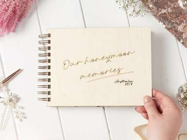 Rustic ring binder with cream background and 'Our honeymoon memories' in gold script
