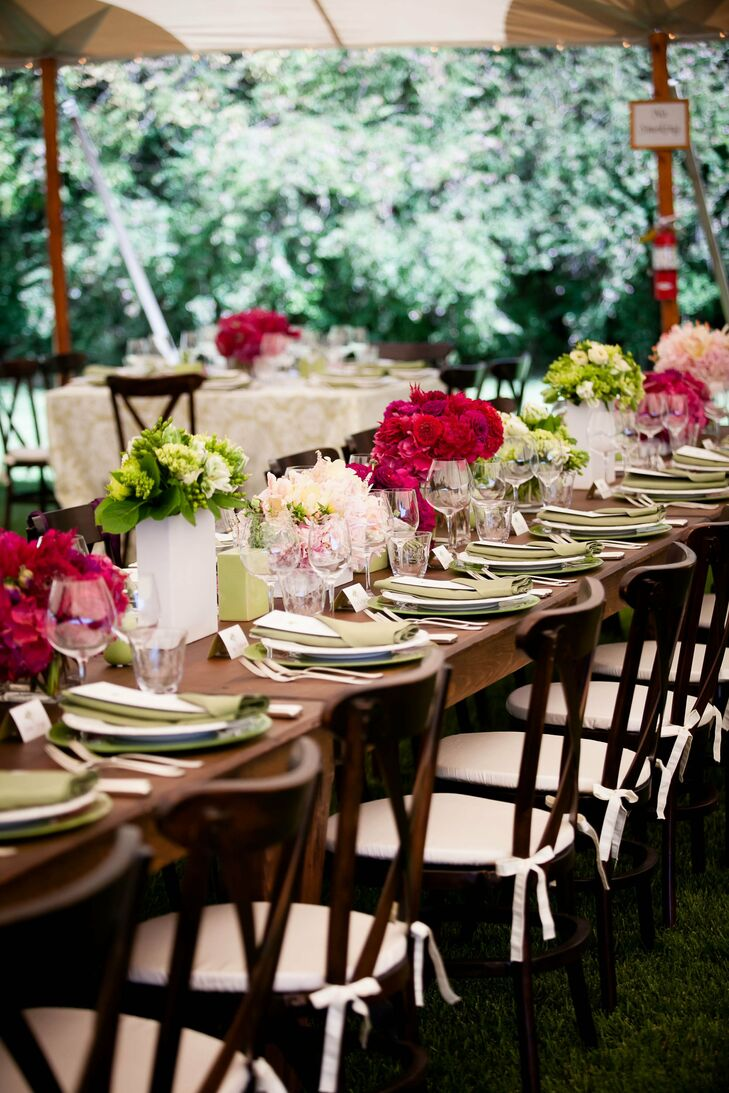 Bouquets from the ceremony were repurposed with green and white arrangements at the reception.