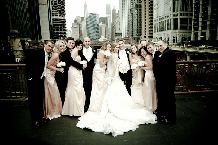 Bridesmaids wore blush-colored charmeuse dresses by Melissa Sweet.