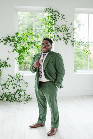 Groom in Green Suit for Enchanting Elopement Ceremony