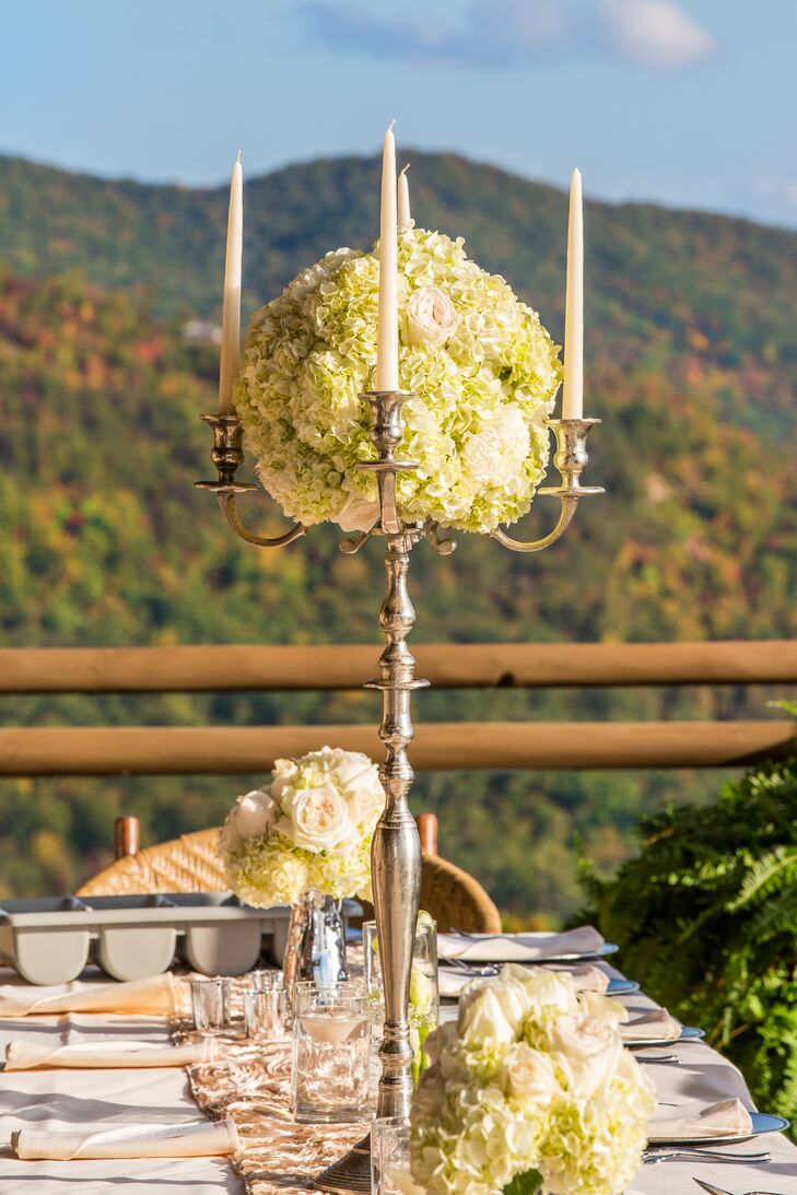A combination of roses, hydrangeas and astilbes in topped the regal silver candelabras.