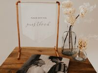 Minimalist type on linen cloth fabric, copper stand