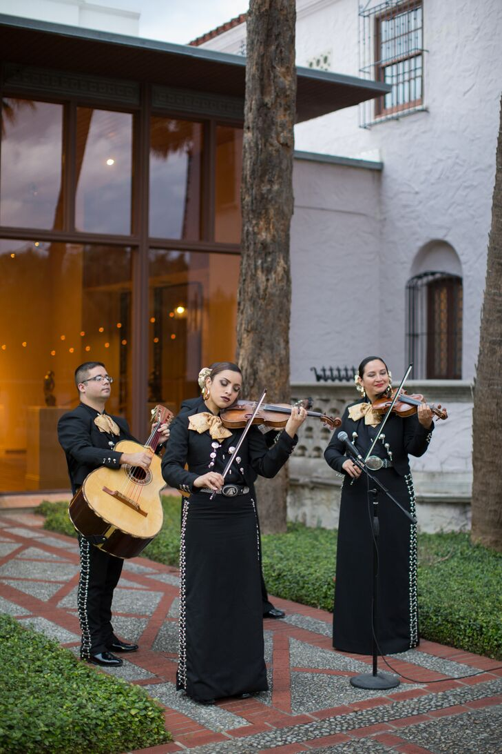 """""""We wanted mariachi to play throughout the ceremony, then start playing as soon as we kissed,"""" Alicia says. """"Mariachi [bands] are so joyous and fun that we wanted our exit to be the kick-off to the party."""""""
