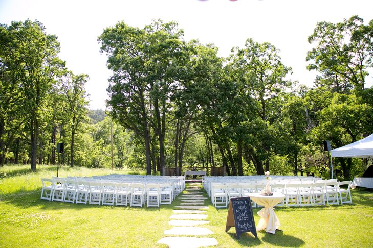 """In search of the perfect outdoor venue, Kaylora and Justin eventually chose the Game Lodge in Custer State Park for both their ceremony and reception. """"After hearing nothing but great things about the lodge, we decided it was the perfect place to say 'I do',"""" Kaylora says. """"It's such a beautiful space nestled in the Black Hills and it's surrounded by trees and a flowing creek. It's just amazing."""""""