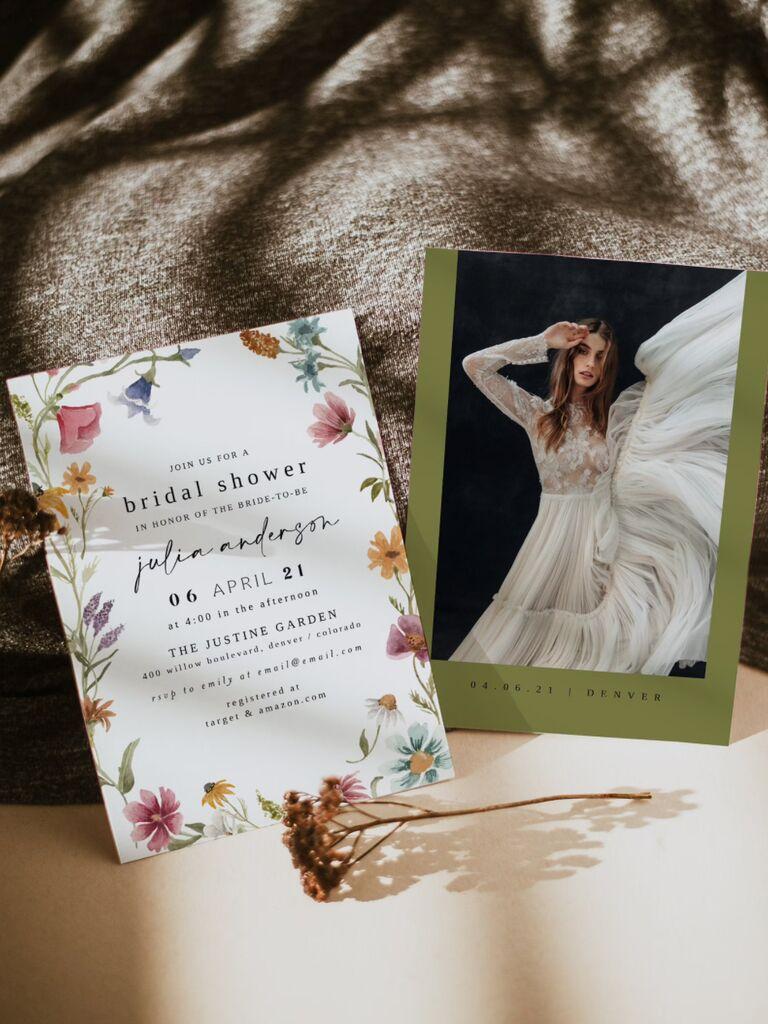 Invitation with garden flowers bordering event details in minimalist black type
