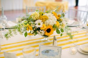 Bright Centerpiece with Sunflowers and Daisies on Striped Table Runner