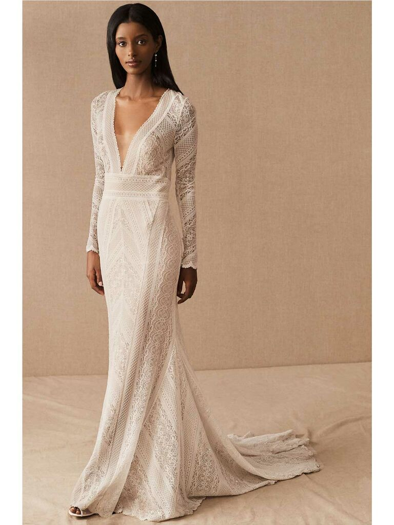 Long sleeve plunging V-neck lace wedding dress