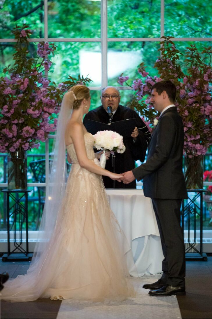 Two towering arrangements of pink stock flowers flanked the altar space where Jessica and Kevin said their vows.