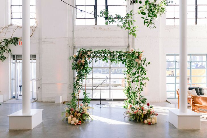 Greenery-Covered Ceremony Arch at Sound River Studios in Long Island City, New York