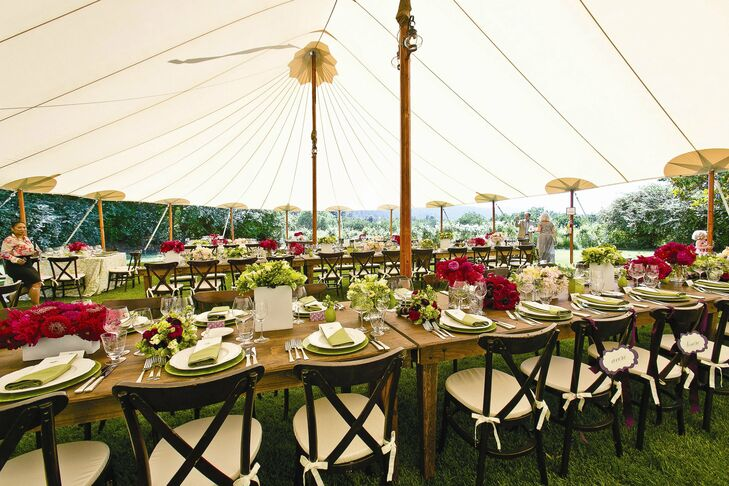 Two large queen's tables without table linens made up the center of the reception tent, while smaller tables with tablecloths made up the perimeter.