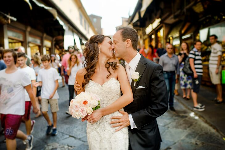 """Saying """"I do"""" at a 13th-century castle in Tuscany sounds too good to be true, but that's just what Lindsay Cantrell (26 and works in sales) and Robert"""