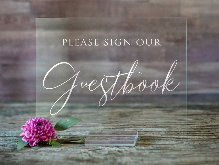 Rectangle acrylic sign saying 'Please sign our guestbook' in elegant white type