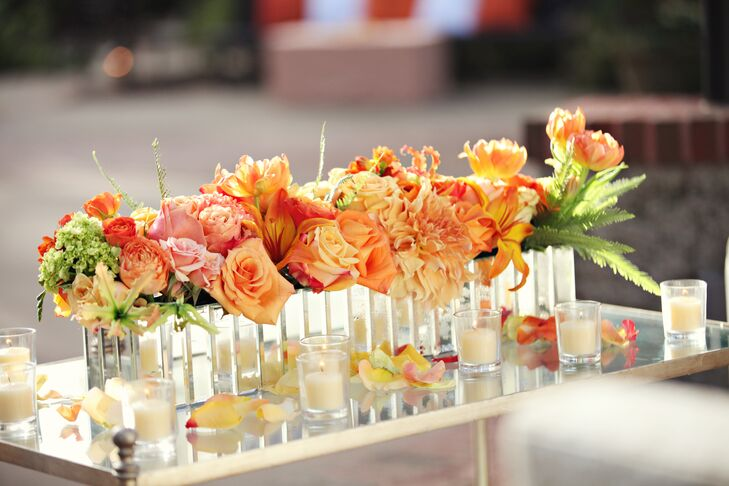 A long orange floral arrangement filled a mirrored glass vase and decorated the contemporary lounge.