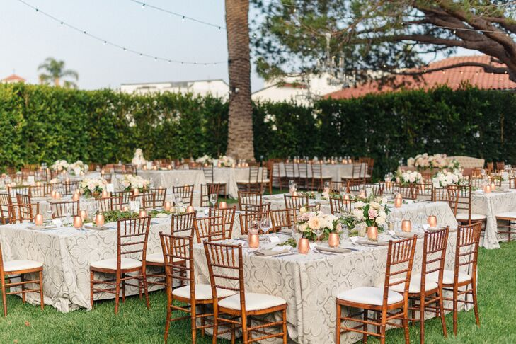 For the reception at the Riviera Mansion in Santa Barbara, California, guests sat under string lights, which added soft light as the sun went down.