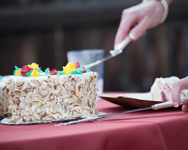 Sharon and Eric enjoyed a two-layer yellow butter cake filled with German wine custard and raspberry filling. It was cover in marzipan and vanilla buttercream icing and toasted almonds.