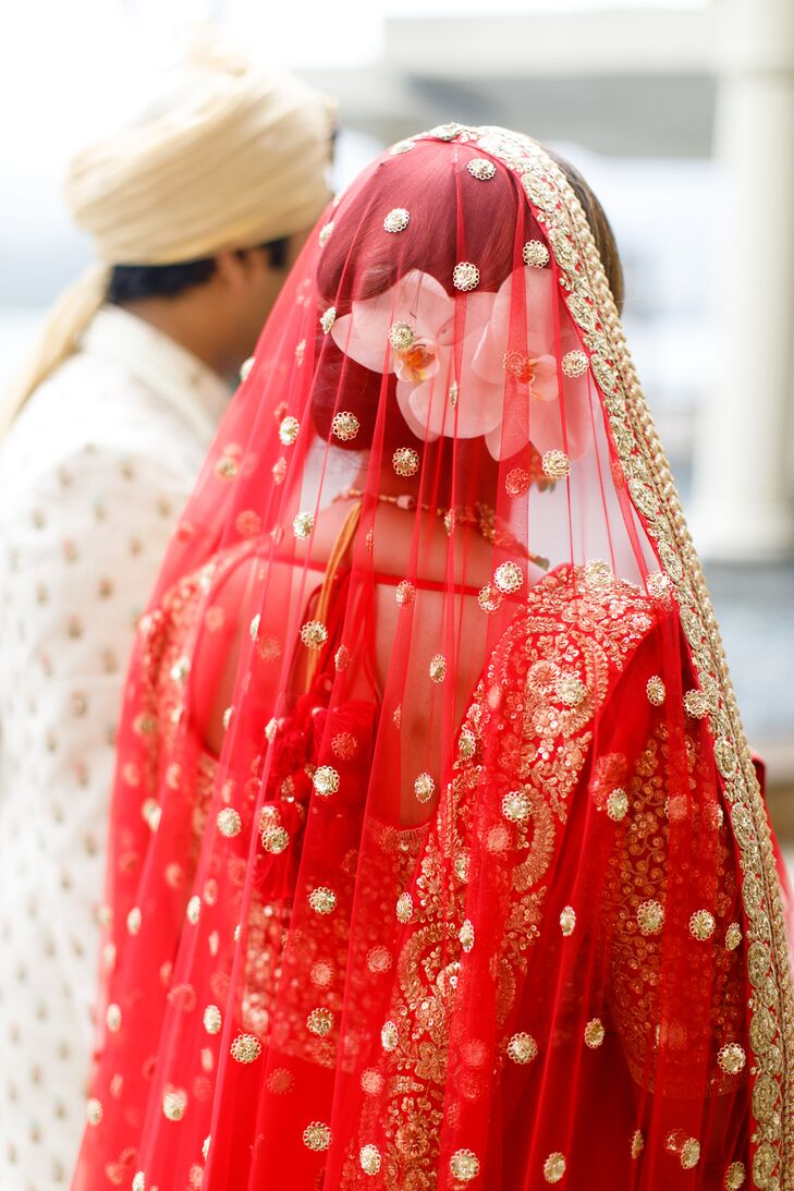 Hindu Bride with Red Jeweled Veil and Orchid Hairpiece