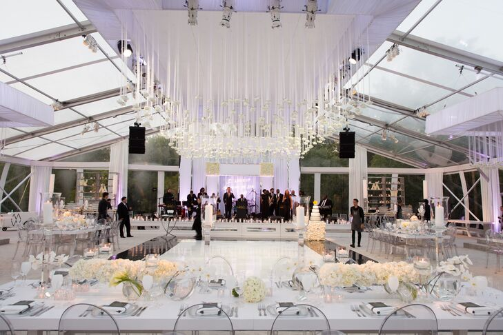Hundreds of sheer, white ribbons and white roses were suspended from the tent's roof to create a one-of-a-kind ceiling centerpiece over the dance floor.