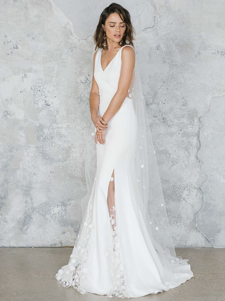 Fitted wedding dress with V-neck and sheer lace overlay